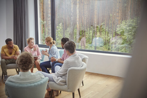 Women talking in group therapy session - CAIF07499