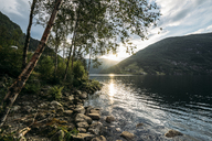 Sun setting over tranquil lake, Norway - CAIF07605