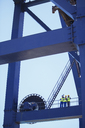 Workers standing on crane - CAIF07644