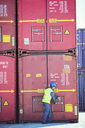 Worker opening cargo container - CAIF07650