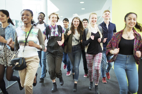 Group of cheerful students running in corridor - CAIF07710