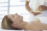 Woman receiving massage at spa - CAIF07797