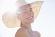 Woman wearing sun hat outdoors - CAIF07812