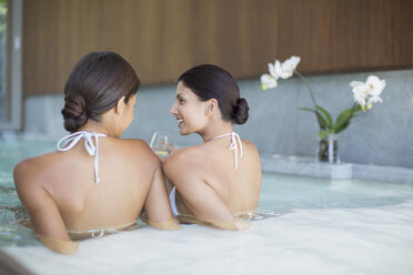 Women relaxing together in spa pool - CAIF07830