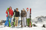 Portrait of skiers standing on snow covered field against clear sky - CAVF01403