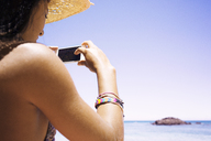 Woman photographing at beach - CAVF01457