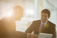 Businessmen using digital tablet in office - CAIF08000