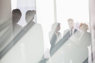 Business people talking in sunny office - CAIF08003
