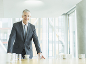 Businessman standing in office - CAIF08006