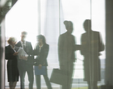Reflection of business people talking in office - CAIF08018