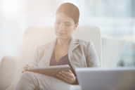Businesswoman using digital tablet - CAIF08021