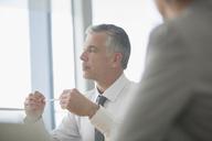 Businessman talking in meeting - CAIF08027