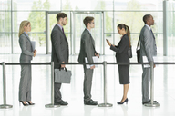 Business people waiting in line - CAIF08096