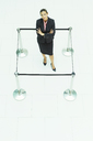 Businesswoman standing in roped-off square - CAIF08105