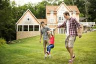 Men swinging girl in backyard - CAVF01682