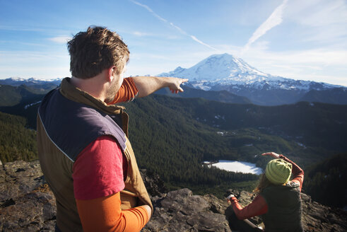 Couple looking at snowcapped mountain - CAVF01790