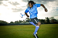 Man practicing soccer on field - CAVF01943