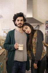 Portrait of couple standing in kitchen - CAVF02057