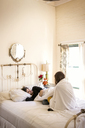 Couple relaxing on bed at home - CAVF02066