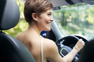 Woman looking away while driving car - CAVF02183