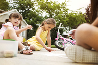 Girls drawing with chalk on road - CAVF02228