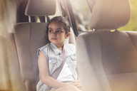 Girl looking away while sitting in car - CAVF02237