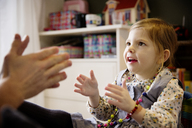 Happy girl playing with father at home - CAVF02411