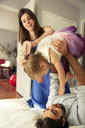 Happy parents with girl at home - CAVF02801