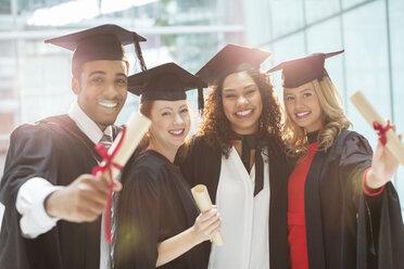 Graduates smiling with diploma - CAIF08186