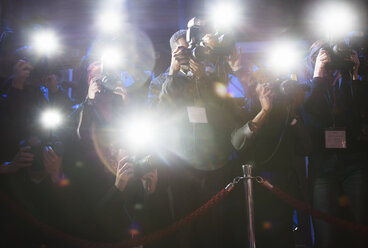 Paparazzi using flash photography at red carpet event - CAIF08237