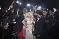 Female celebrity being interviewed on red carpet - CAIF08240