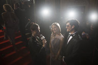 Celebrity couple being interviewed on red carpet - CAIF08279