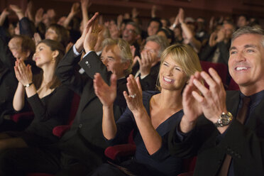 Enthusiastic audience clapping in theater - CAIF08297