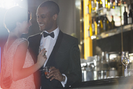 Well dressed couple at luxury bar - CAIF08378