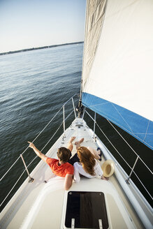 High angle view of couple sitting in yacht - CAVF03937
