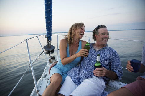Couple enjoying drink while traveling in yacht - CAVF03952