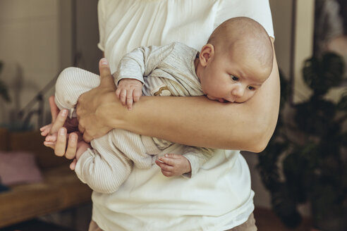 Newborn baby being held in mother's arms - MFF04393