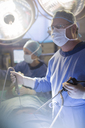 Surgeon performing laparoscopic surgery in operating theater - CAIF08459