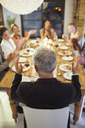 Friends applauding at dinner party - CAIF08498