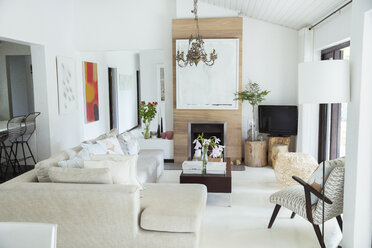 Sofa, coffee table and fireplace in modern living room - CAIF08507