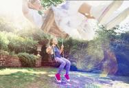 Girls swinging in backyard - CAIF08861