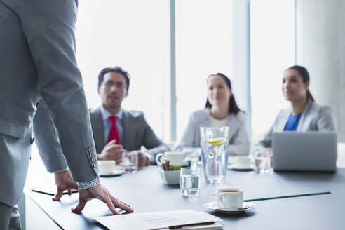 Businessman leading meeting in conference room - CAIF08951