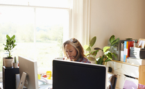 Focused woman working in home office - CAIF09020