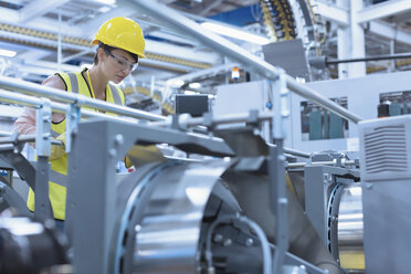 Worker at machinery in factory - CAIF09065
