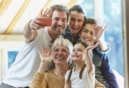 Multi-generation family waving and taking selfie - CAIF09161
