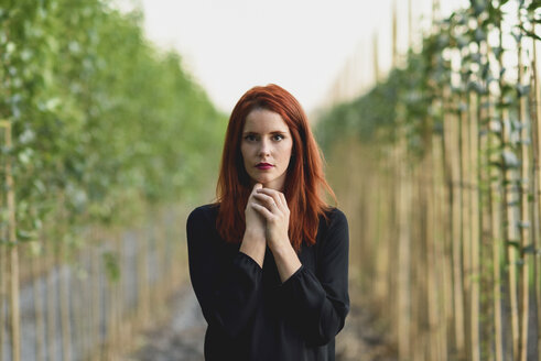 Portrait of redheaded young woman  in nature - JSMF00122