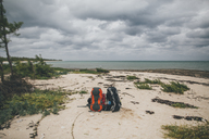 Cuba, Puerto Padre, Bahia de Malagueta, Two abandoned rucksacks on the beach - GUSF00549