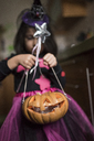 Little girl with Jack O'Lantern at Halloween - JASF01852