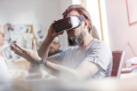 Male design professional using virtual reality simulator glasses in office - CAIF09288