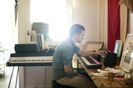 Man playing piano at home - CAVF04497